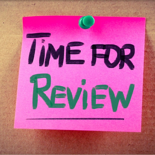 Pink post-it note with the words 'Time for Review' written on it.