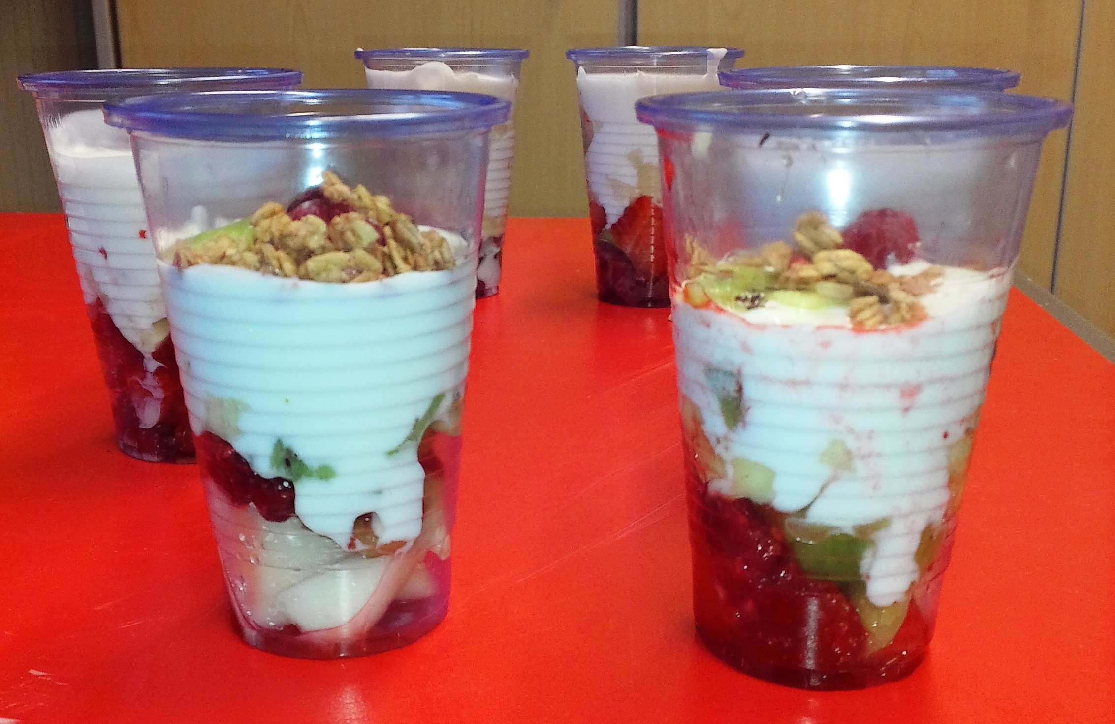 Fruit yoghurt pots topped with granola
