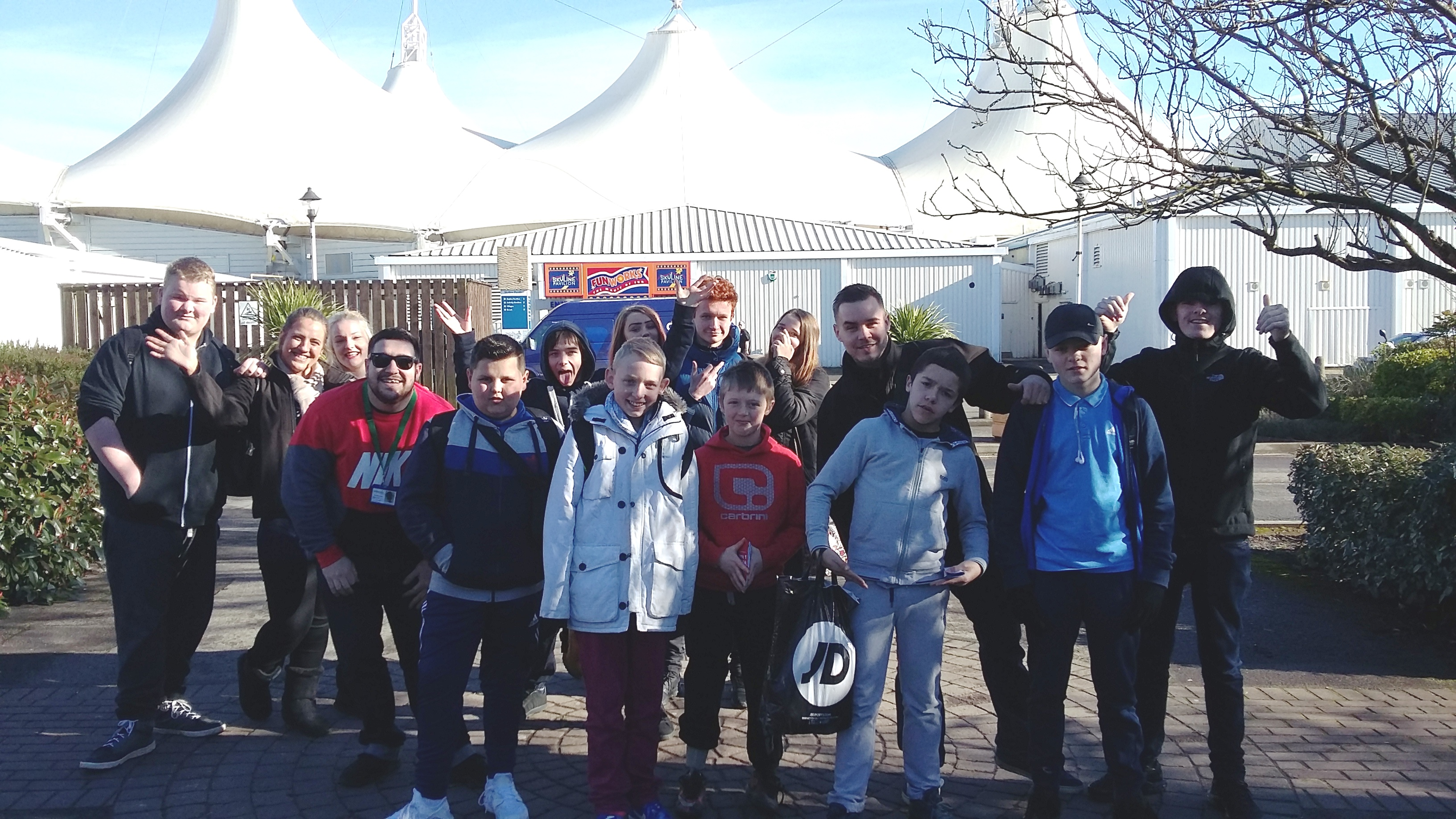 A group of young people pose for a photograph outside of Butlins in Skegness